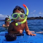 Snorkel Kid on a Boogie Board with Tiny Bubbles Scuba