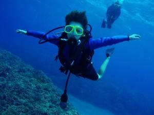 Tiny Diver in flight with Tiny Bubbles Scuba