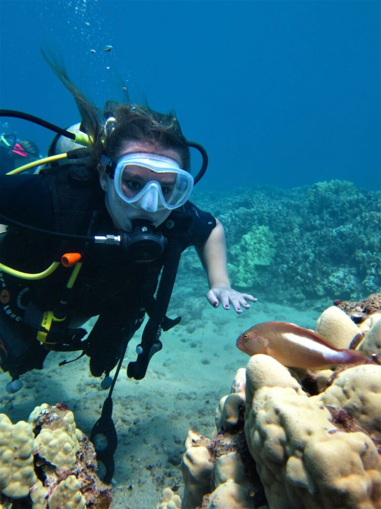 Diver with Freckled Hawkfish at Airport Beach with Tiny Bubbles Scuba