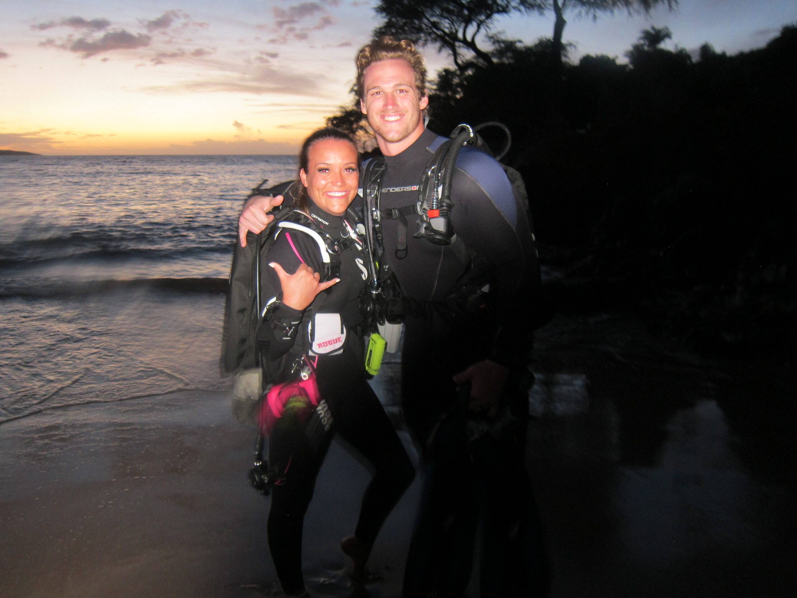 Night Dive sunset couple with Tiny Bubbles at Makena Landing